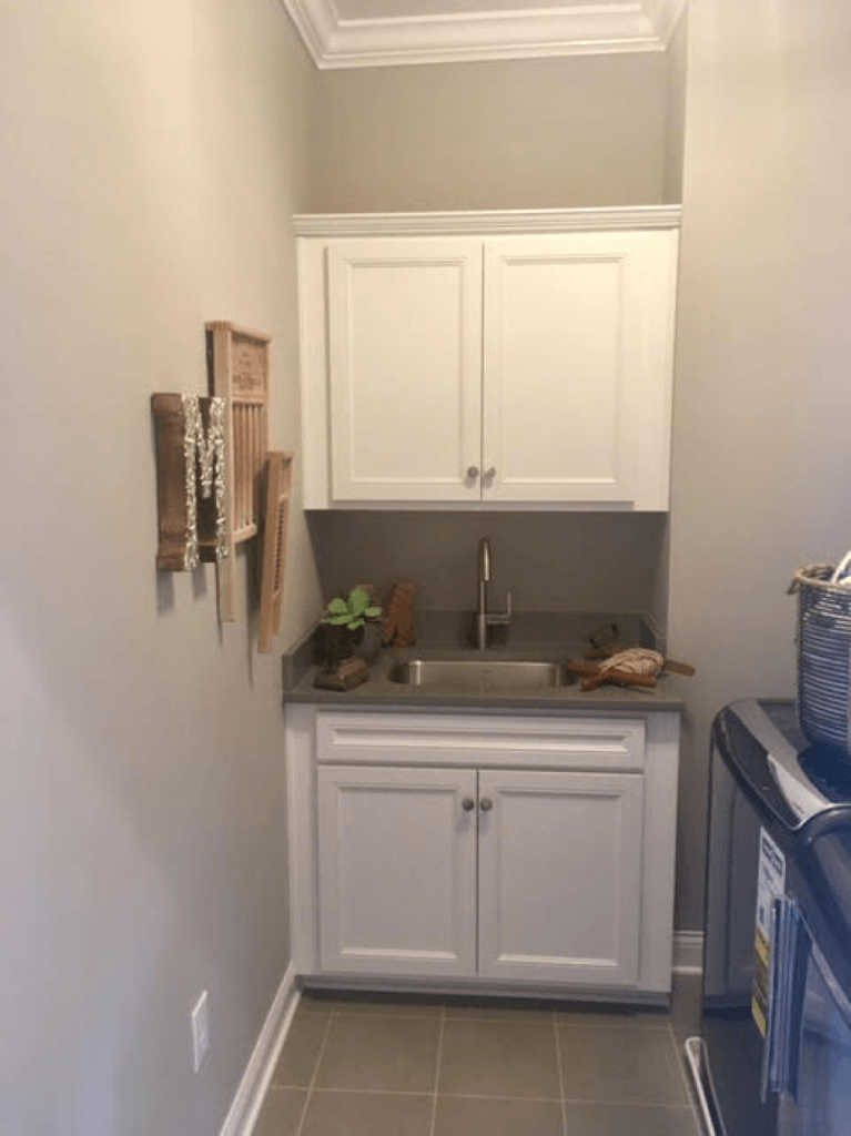 Washing room with grey painted walls