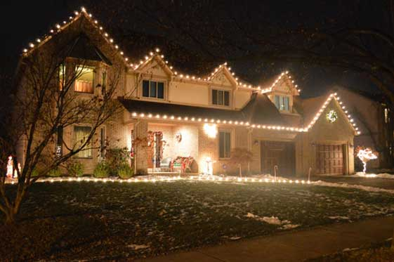Exterior holiday lighting on house