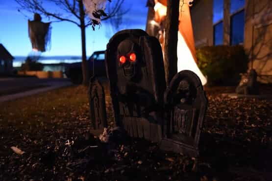 Halloween lawn decoration of gravestone with a skull