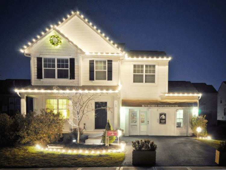 White home with holiday lighting