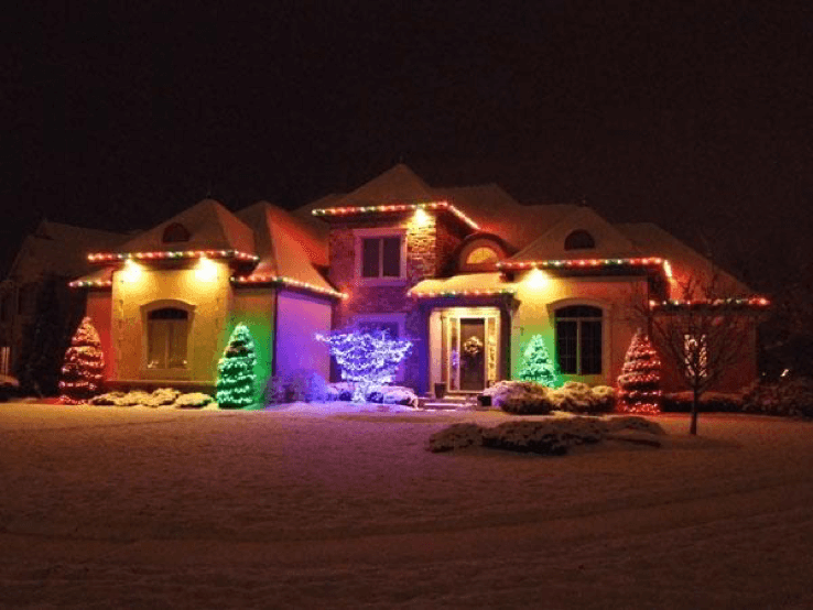 Home with multi-colored holiday lighting