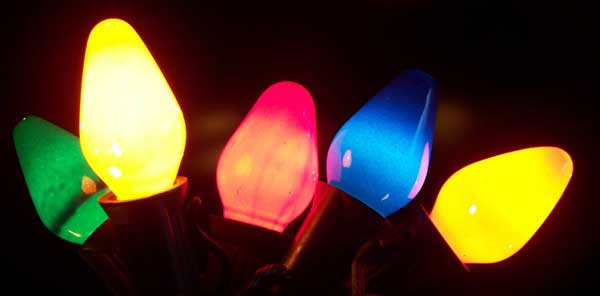 Close up of colored holiday light bulbs