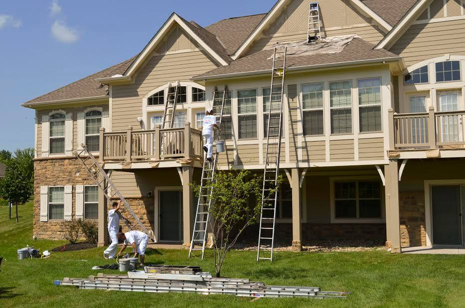 Painters painting exterior of a home